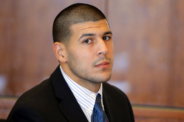 """FILE - In this Oct. 9, 2013, file photo, former New England Patriots NFL football player Aaron Hernandez attends a pretrial court hearing in Fall River, Mass. Massachusetts prosecutors are seeking recordings of jailhouse phone calls by the former football player, who they say used """"coded messages"""" to communicate about the murder case against him. Hernandez has pleaded not guilty to murder in the killing of 27-year-old Odin Lloyd. (AP Photo/Brian Snyder, Pool, File)"""