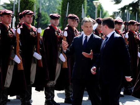 FILE PHOTO: Macedonian Prime Minister Nikola Gruevski (R) and his Hungarian counterpart Viktor Orban review a military guard of honor in Skopje May 12, 2011.  REUTERS/Ognen Teofilovski/File Photo