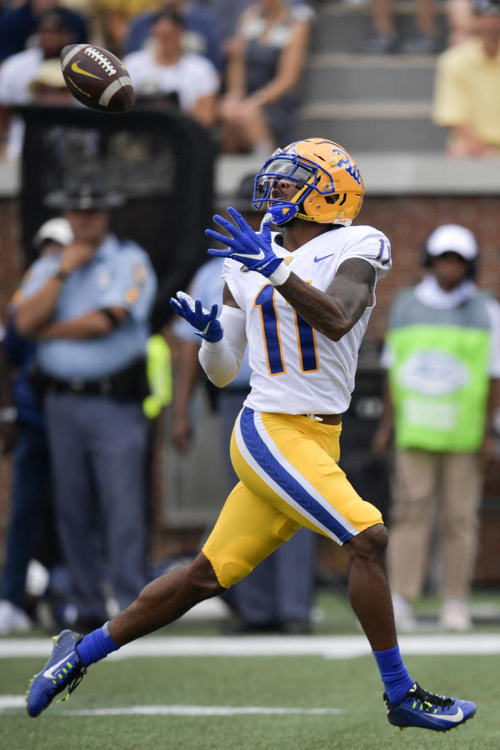 Pittsburgh wide receiver Taysir Mack (11) makes a catch during the first half of an NCAA college football game against Georgia Tech, Saturday, Oct. 2, 2021, in Atlanta. Mack scored a tochdown on the play. (AP Photo/Mike Stewart)