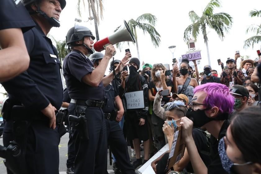 Chief of Police of Los Los Angeles, Michel Moore, address protesters at 3rd and Fairfax, in front of the Farmers Market on Saturday, May 30, 2020.