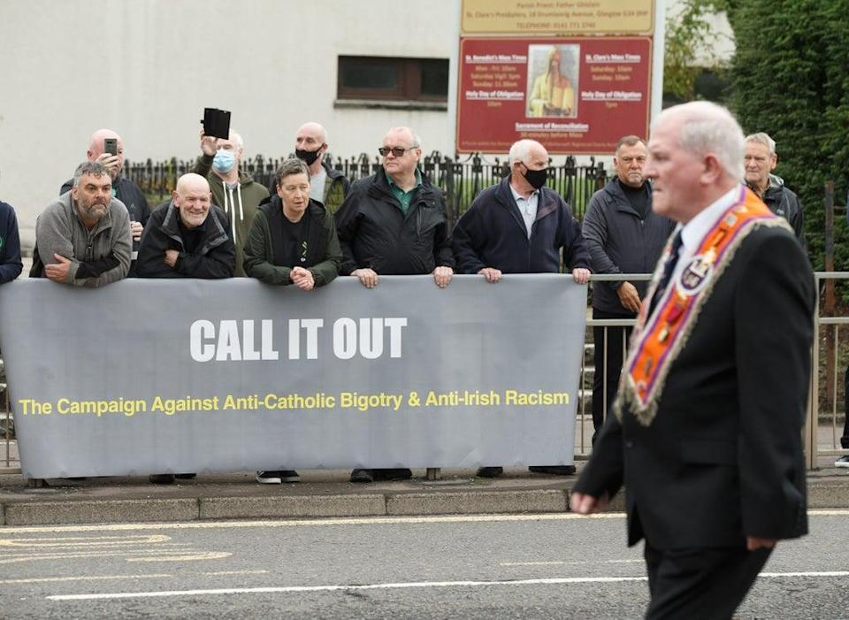 A Call It Out banner in Easterhouse (Robert Perry/PA) (PA Wire)