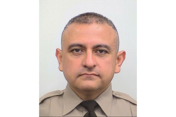 """This undated image released by Maricopa County Sheriff's Office shows Deputy Juan """"Johnny"""" Ruiz. Ruiz, a metro Phoenix sheriff's deputy who suffered grave injuries at the hands of a man he had just arrested, succumbed to injuries he suffered on Saturday, Oct. 9, 2021. Ruiz died Monday, Oct. 11, authorities said. The man accused of attacking Ruiz, 30-year-old Clinton Robert Hurley, remained hospitalized in stable condition Monday after getting in a gunfight with a homeowner. (Maricopa County Sheriff's Office via AP)"""