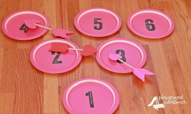 """<p>Your little ones will love this basic-yet-fun activity that involves tossing DIY heart arrows onto paper plates for points — plus, they'll have lots of fun decorating these adorable """"cupid's arrows,"""" too. </p><p><em><a href=""""https://playgroundparkbench.com/valentines-day-game-cupids-arrow-toss/"""" rel=""""nofollow noopener"""" target=""""_blank"""" data-ylk=""""slk:Get the tutorial at Playground Parkbench »"""" class=""""link rapid-noclick-resp"""">Get the tutorial at Playground Parkbench »</a></em></p>"""