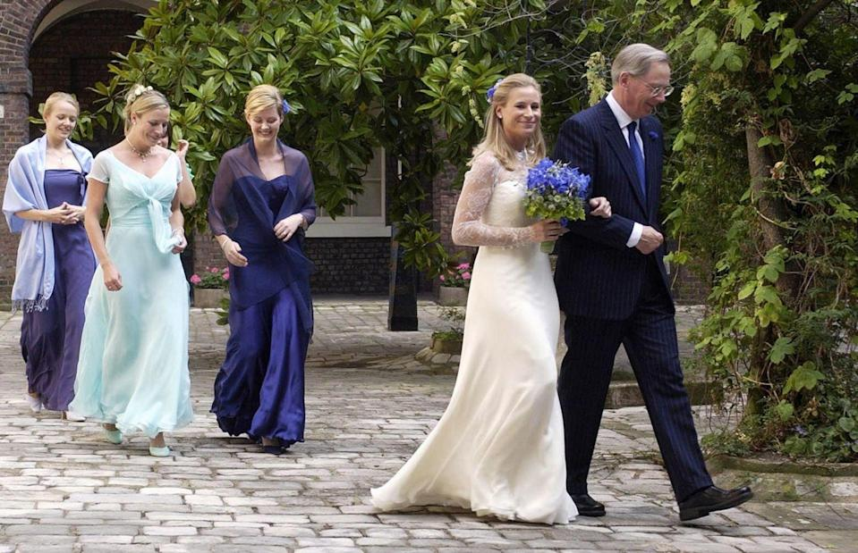 <p>Around the mid-2000s, it became more common for the maid of honor to wear a different color than the rest of the bridal party. Here, Lady Davina Windsor's MOH wears teal, while the rest of her party is in violet. </p>
