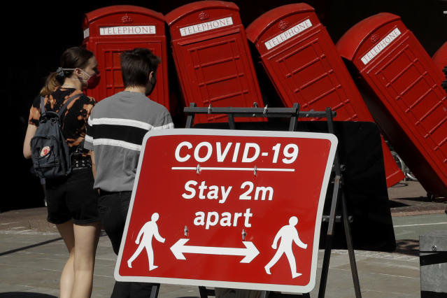 The two-metre social distancing rule is being reviewed by the UK government. (AP)