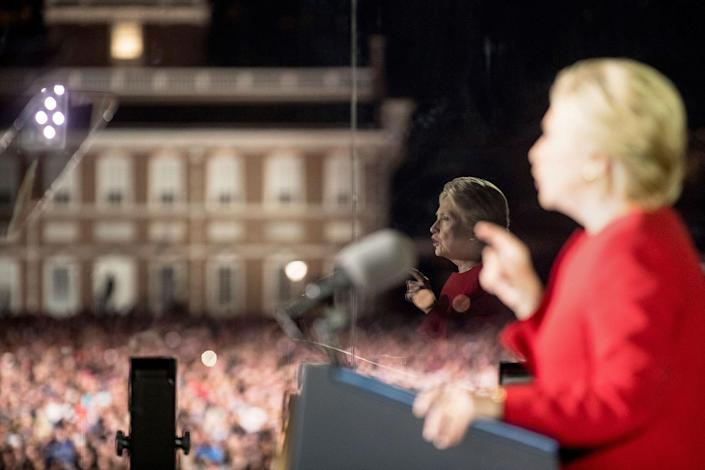 <p>Democratic presidential candidate Hillary Clinton, seen in reflection, speaks at a rally at Independence Mall in Philadelphia, Monday, Nov. 7, 2016. (Photo: Andrew Harnik/AP) </p>