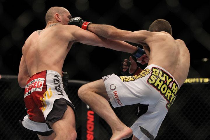 LAS VEGAS, NV - MAY 26:  (L-R) Paul Sass punches Jacob Volkmann during a lightweight bout at UFC 146 at MGM Grand Garden Arena on May 26, 2012 in Las Vegas, Nevada.