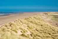 """<p>The magic of Holkham Beach lies in its endless swathes of golden sand backed by pine-clad dunes. Rich in wildlife and welcoming to four-legged friends, it's an animal-lover's paradise. A visit in winter is a life-affirming affair, filled with wind-whipped walks and big skies that seemingly go on forever. Head to the Holkham Beach Cafe for heart - and hand- warming hot chocolates with a view.</p><p><strong>Where to stay:</strong> Set up base at <a href=""""https://www.countrylivingholidays.com/offers/norfolk-kings-lynn-burnham-market-hoste-arms-hotel"""" rel=""""nofollow noopener"""" target=""""_blank"""" data-ylk=""""slk:The Hoste Arms"""" class=""""link rapid-noclick-resp"""">The Hoste Arms</a>, a cosy outpost in the beautiful Georgian town of Burnham Market, just a 20 minute drive from Holkham. </p><p><a href=""""https://www.countrylivingholidays.com/offers/norfolk-kings-lynn-burnham-market-hoste-arms-hotel"""" rel=""""nofollow noopener"""" target=""""_blank"""" data-ylk=""""slk:Read our review of The Hoste Arms"""" class=""""link rapid-noclick-resp"""">Read our review of The Hoste Arms</a>.</p><p><a class=""""link rapid-noclick-resp"""" href=""""https://go.redirectingat.com?id=127X1599956&url=https%3A%2F%2Fwww.booking.com%2Fhotel%2Fgb%2Fthe-hoste-luxury-boutique-hotel.en-gb.html%3Faid%3D2070935&sref=https%3A%2F%2Fwww.countryliving.com%2Fuk%2Ftravel-ideas%2Fstaycation-uk%2Fg34437103%2Fbritain-best-winter-beaches%2F"""" rel=""""nofollow noopener"""" target=""""_blank"""" data-ylk=""""slk:CHECK AVAILABILITY"""">CHECK AVAILABILITY</a></p>"""