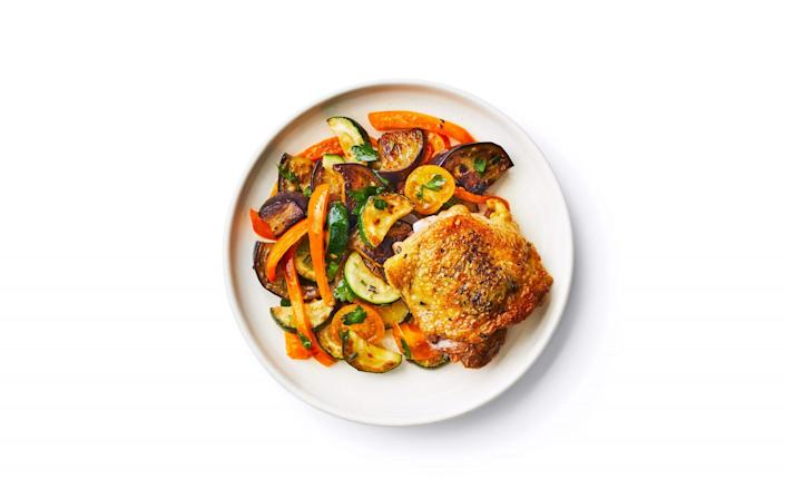 """<p><strong>Recipe: <a href=""""https://www.southernliving.com/recipes/rosemary-chicken-thighs-summer-vegetables"""" rel=""""nofollow noopener"""" target=""""_blank"""" data-ylk=""""slk:Rosemary Chicken Thighs With Summer Vegetables"""" class=""""link rapid-noclick-resp"""">Rosemary Chicken Thighs With Summer Vegetables</a> </strong></p> <p>There's nothing we love more during a busy week than a sheet pan supper that makes dish duty a piece of cake. This healthy dinner is the perfect example of """"eating the rainbow"""" with your veggies.</p>"""