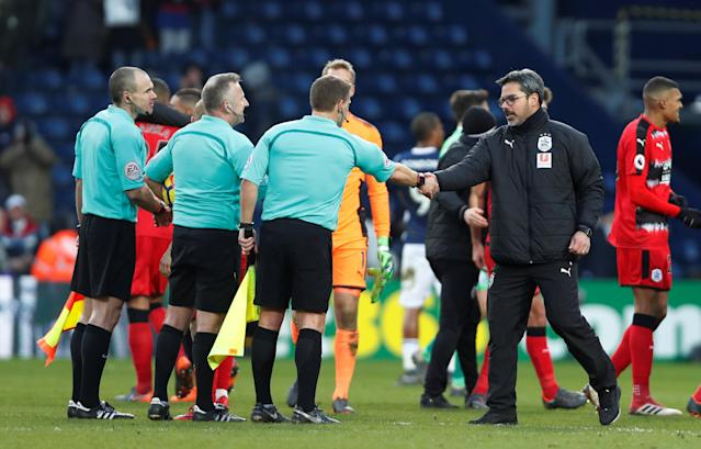 """Soccer Football - Premier League - West Bromwich Albion vs Huddersfield Town - The Hawthorns, West Bromwich, Britain - February 24, 2018 Huddersfield Town manager David Wagner shakes hands with the match officials after the match Action Images via Reuters/Paul Childs EDITORIAL USE ONLY. No use with unauthorized audio, video, data, fixture lists, club/league logos or """"live"""" services. Online in-match use limited to 75 images, no video emulation. No use in betting, games or single club/league/player publications. Please contact your account representative for further details."""
