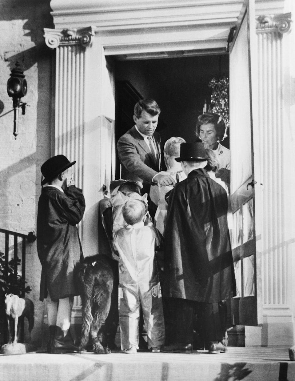 """<p>Attorney General Robert F. Kennedy and his wife, Ethel, give out Halloween candy to kids during a """"Trick of Treat for UNICEF"""" event. </p>"""
