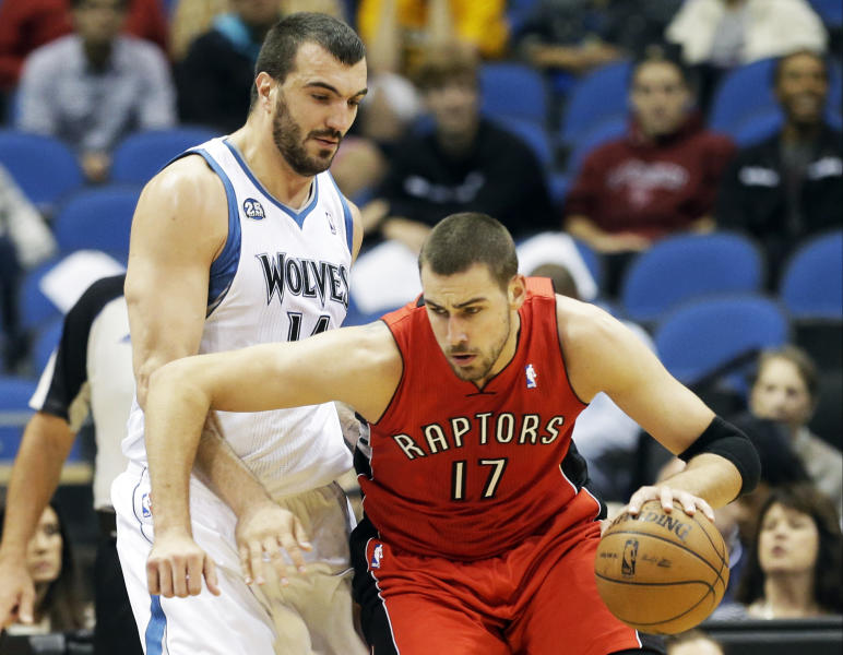 Toronto Raptors' Jonas Valanciunas, right, of Lithuania, drives around Minnesota Timberwolves' Nikola Pekovic, of Montenegro, in the first quarter of an NBA preseason basketball game on Saturday, Oct. 12, 2013, in Minneapolis. (AP Photo/Jim Mone)