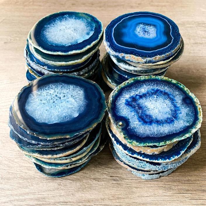 """These stunning coasters are made of Brazilian agate—no two slices are alike. They're available in pink, purple, natural, green, and blue (pictured) and come in sets of four. $10, Etsy. <a href=""""https://www.etsy.com/listing/834047827/blue-agate-coasters-30-35-bulk-geode"""" rel=""""nofollow noopener"""" target=""""_blank"""" data-ylk=""""slk:Get it now!"""" class=""""link rapid-noclick-resp"""">Get it now!</a>"""