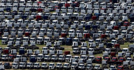 FILE PHOTO: New Ford trucks are seen at a parking lot of the Ford factory in Sao Bernardo do Campo, Brazil, February 12, 2015.  REUTERS/Paulo Whitaker/File Photo