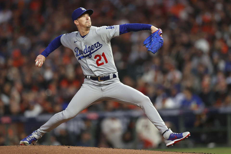 Los Angeles Dodgers' Walker Buehler pitches against the San Francisco Giants during the first inning of Game 1 of a baseball National League Division Series Friday, Oct. 8, 2021, in San Francisco. (AP Photo/John Hefti)
