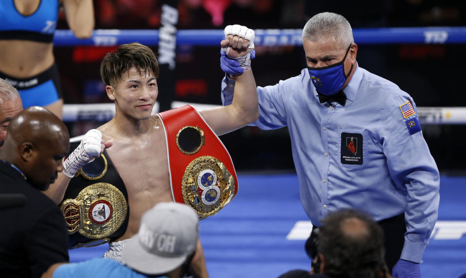 LAS VEGAS, NEVADA - JUNE 19: WBA/IBF bantamweight champion Naoya Inoue of Japan has his arm raised by referee Russell Mora after stopping Michael Dasmarinas of the Philippines in the third round of their title fight at Virgin Hotels Las Vegas on June 19, 2021 in Las Vegas, Nevada. (Photo by Steve Marcus/Getty Images)