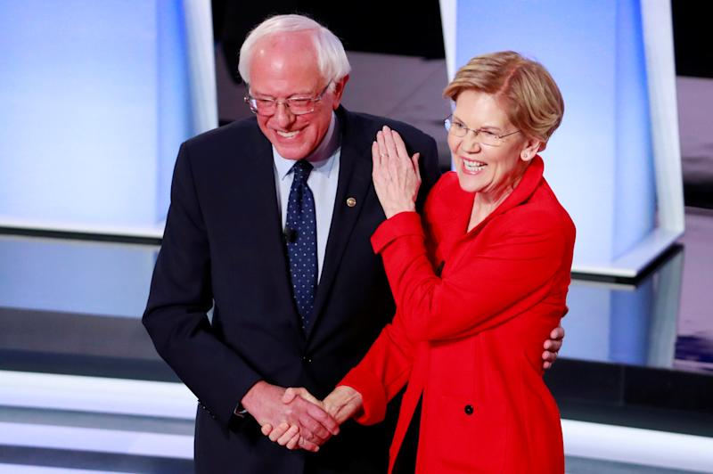 U.S. Senator Bernie Sanders and U.S. Senator Elizabeth Warren shake hands before the start of the first night of the second 2020 Democratic U.S. presidential debate in Detroit, Michigan, U.S., July 30, 2019. REUTERS/Lucas Jackson TPX IMAGES OF THE DAY