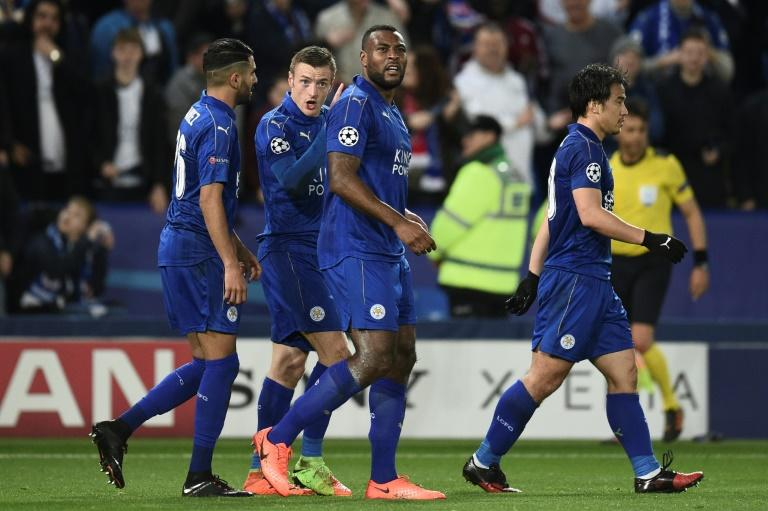 Leicester City's Wes Morgan (3rd L)) celebrates with teammates after scoring a goal during their UEFA Champions League round of 16 2nd leg match against Sevilla, at the King Power Stadium in Leicester, on March 14, 2017