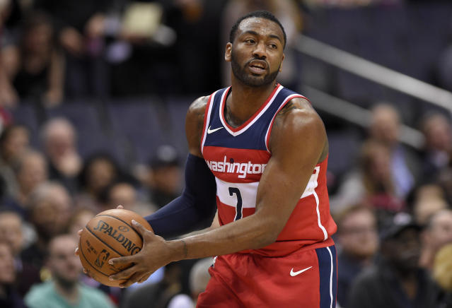 "<a class=""link rapid-noclick-resp"" href=""/nba/players/4716/"" data-ylk=""slk:John Wall"">John Wall</a> is one of the GOATs of Christmas gift-giving.(AP Photo/Nick Wass)"