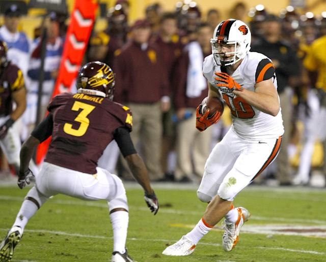 Oregon State tight end Caleb Smith (10) runs against Arizona State defensive back Damarious Randall (3) during the first half of an NCAA college football game on Saturday, Nov. 16, 2013, in Tempe, Ariz. (AP Photo/Rick Scuteri)