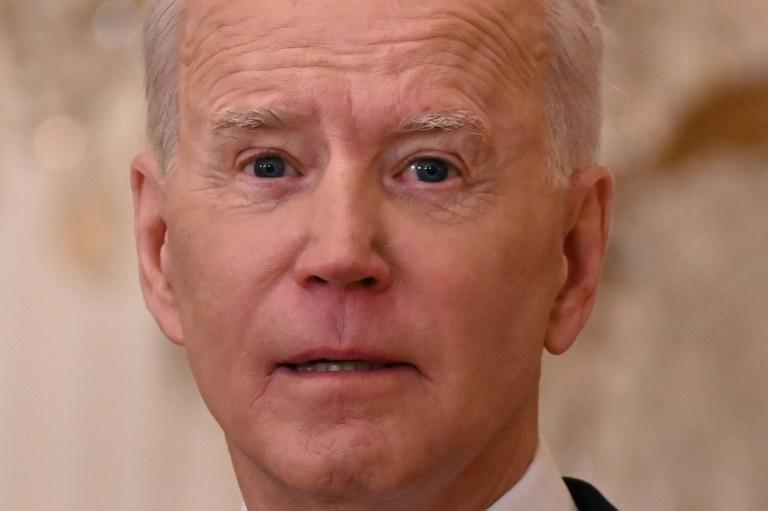US President Joe Biden speaks during his first press conference in the East Room of the White House