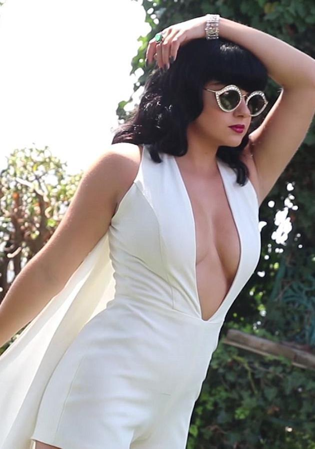 She also wore a stunning white jumpsuit with cape along with some retro sunglasses. Source: LaPalme