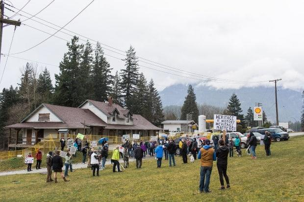 Concerned residents rally around the 1916 Hope Station House in Hope, B.C., in March.