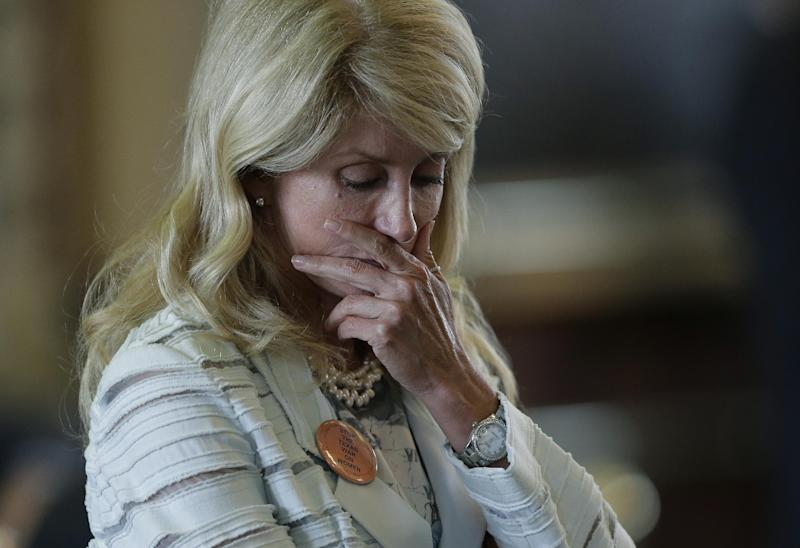 Sen. Wendy Davis, D-Fort Worth, reacts after she was called for a rules violation during her filibusters of an abortion bill, Tuesday, June 25, 2013, in Austin, Texas. Davis was given a second warning for breaking filibuster rules. (AP Photo/Eric Gay)