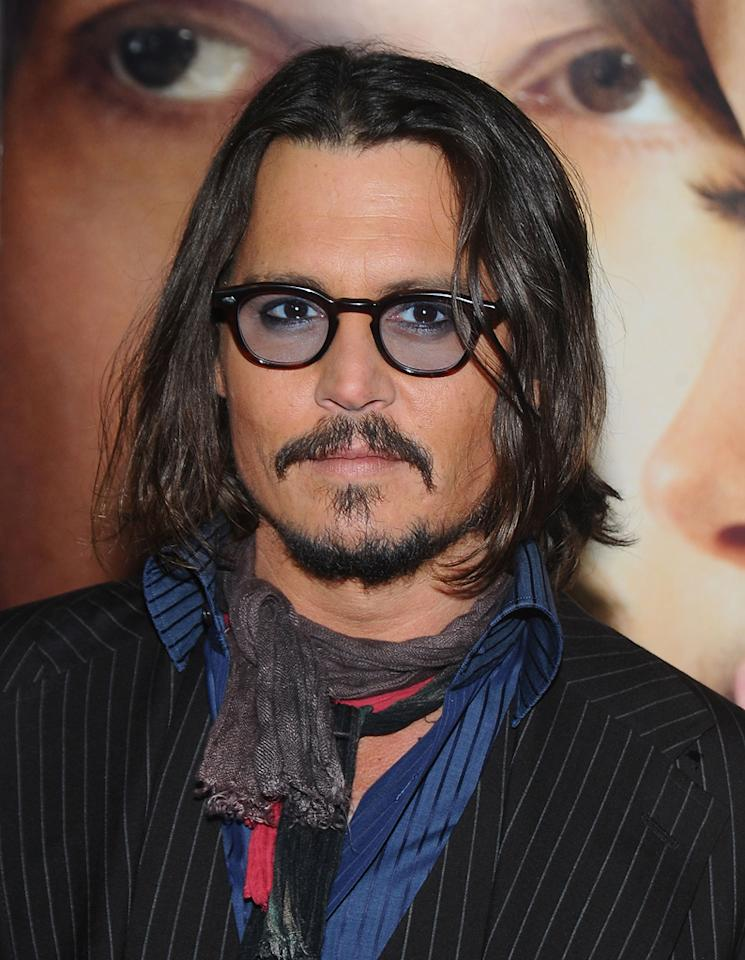"""<a href=""""http://movies.yahoo.com/movie/contributor/1800019485"""">Johnny Depp</a> attends the New York premiere of <a href=""""http://movies.yahoo.com/movie/1810149482/info"""">The Tourist</a> on December 6, 2010."""
