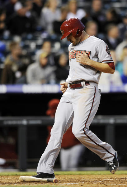 Arizona Diamondbacks' A.J. Pollock scores on a Didi Gregorius RBI single against the Colorado Rockies during the sixth inning of a baseball game on Monday, May 20, 2013, in Denver. (AP Photo/Jack Dempsey)