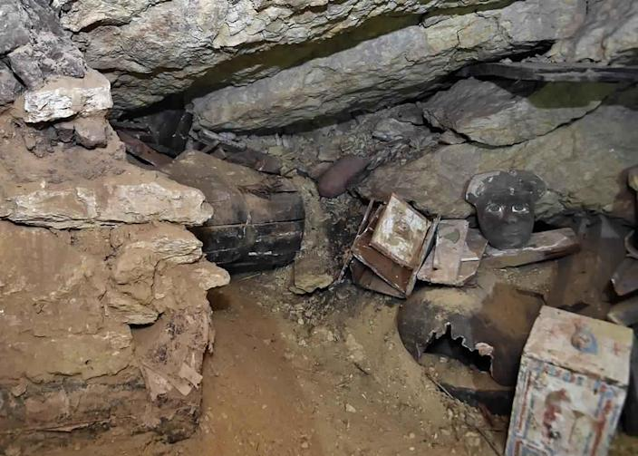 """This undated photo provided by the Egyptian Ministry of Tourism and Antiquities shows a trove of ancient coffins and artifacts that Egyptian archaeologists unearthed in a vast necropolis south of Cairo, authorities said Monday, Oct. 19, 2020, in Saqqara, south of Cairo, Egypt. The Tourism and Antiquities Ministry said in a statement that archaeologists found a """"large number"""" of colorful, sealed sarcophagi buried more than 2,500 years ago. (Ministry of Tourism and Antiquities via AP)"""