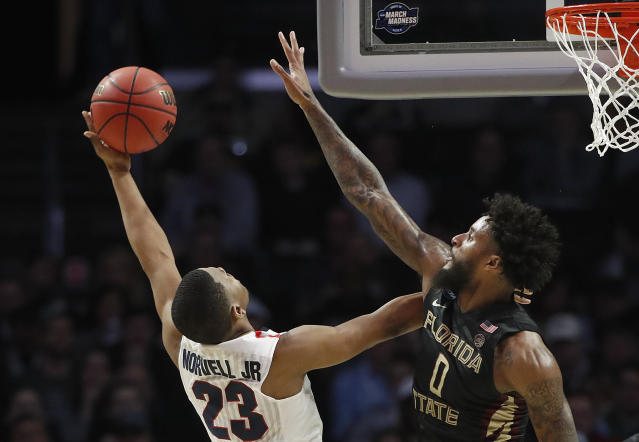 Gonzaga guard Zach Norvell Jr. (23) shoots against Florida State forward Phil Cofer (0) during the first half of an NCAA men's college basketball tournament regional semifinal Thursday, March 22, 2018, in Los Angeles. (AP Photo/Jae Hong)