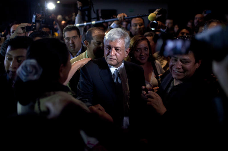 "Mexican presidential candidate Andres Manuel Lopez Obrador of the Democratic Revolution Party (PRD), leaves a hotel after a press conference in Mexico City, Monday, July 2, 2012. After official results showed Enrique Pena Nieto of the Institutional Revolutionary Party (PRI) winning 38 per cent of the vote with more than 92 per cent of the votes counted, Lopez Obrador has not conceded Sunday's elections, telling his supporters Monday evening that, ""We can't accept a fraudulent result,"" a reference to his allegations that Pena Nieto exceeded campaign spending limits, bought votes in some states and benefited from favorable coverage in Mexico's semi-monopolized television industry.(AP Photo/Alexandre Meneghini)"
