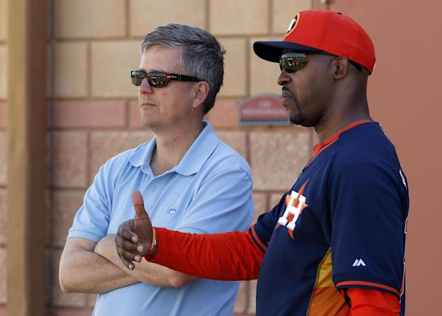 Houston Astros general manager Jeff Luhnow, left, talks with manager Bo Porter during baseball spring training Wednesday, Feb. 19, 2014, in Kissimmee, Fla. (AP Photo/Alex Brandon)