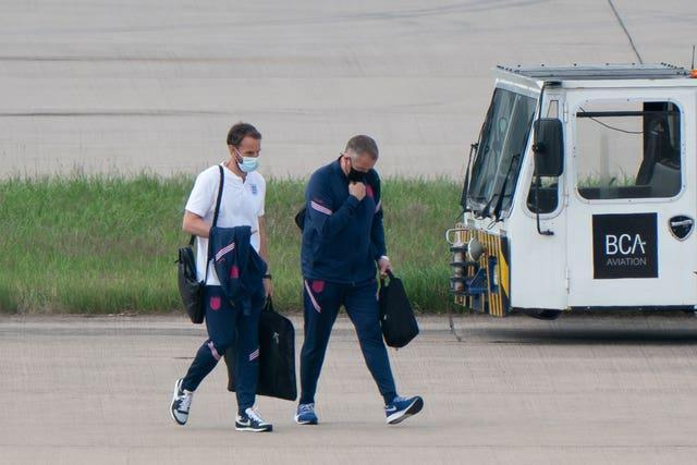 England manager Gareth Southgate walks towards the plane to Rome at Birmingham Airport