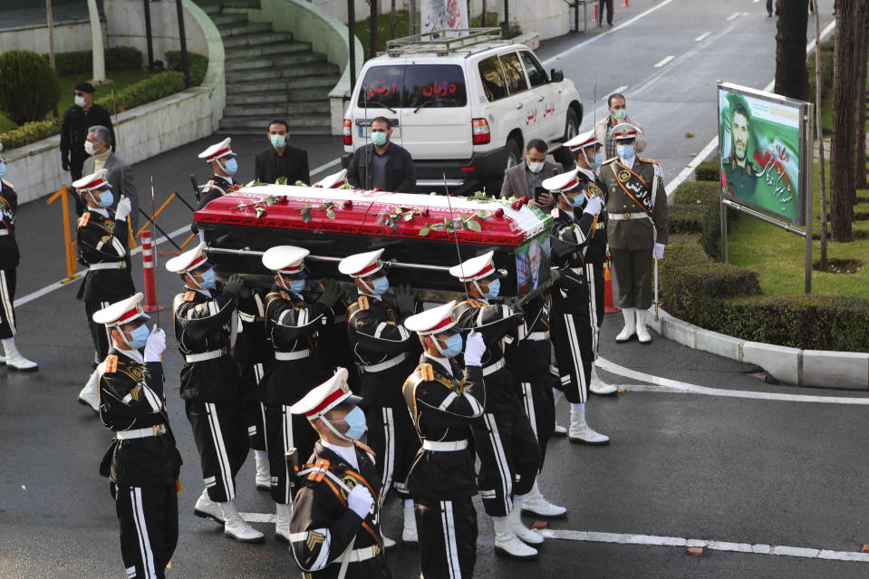 <p>Iranian military personnel carrying the flag-draped coffin of nuclear scientist Mohsen Fakhrizadeh</p> (AP)