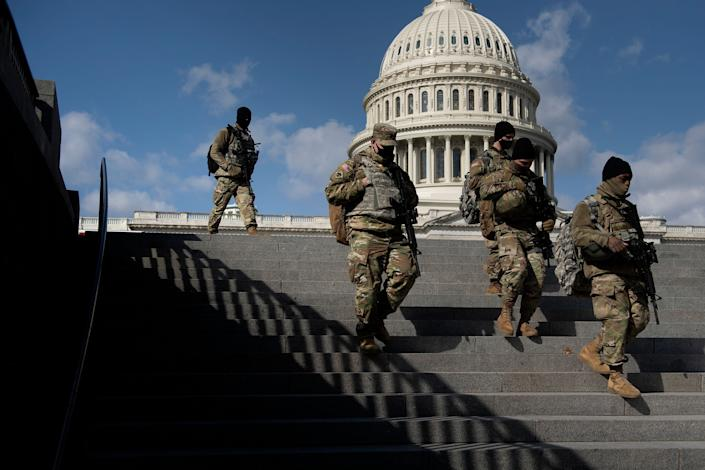 Members of the National Guard patrol the grounds of the U.S. Capitol on March 4, 2021, in Washington, D.C., after the FBI and Homeland Security Department warned that violent militia groups and QAnon followers had discussed attacking the legislature that day. (Photo: BRENDAN SMIALOWSKI via Getty Images)