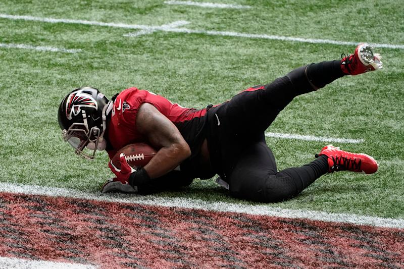 Falcons running back Todd Gurley scores a touchdown against the Lions during the second half of the Lions' 23-22 win on Sunday, Oct. 25, 2020, in Atlanta.