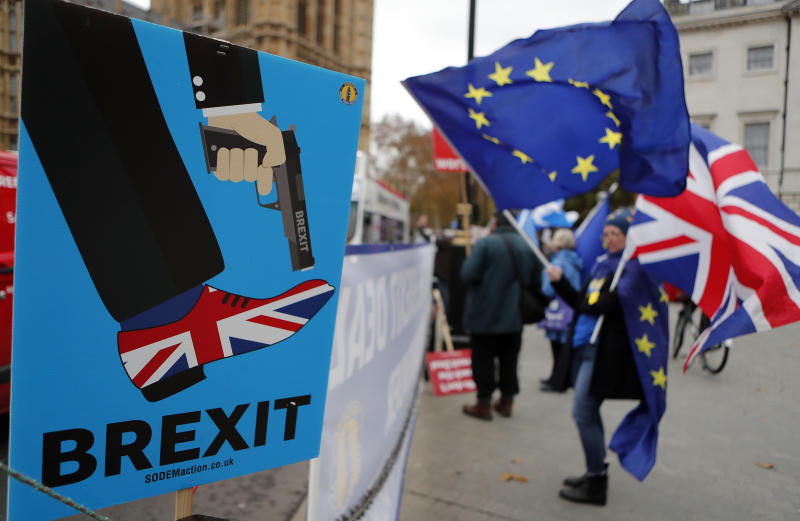 Protestors demonstrate opposite Parliament against Britain's Brexit split from Europe, in London, Thursday, Dec. 6, 2018. Britain's Prime Minister Theresa May's effort to win support for her Brexit agreement comes amid reports in British newspapers Thursday, predicting that Parliament could reject the deal by more than 100 votes. (AP Photo/Frank Augstein)