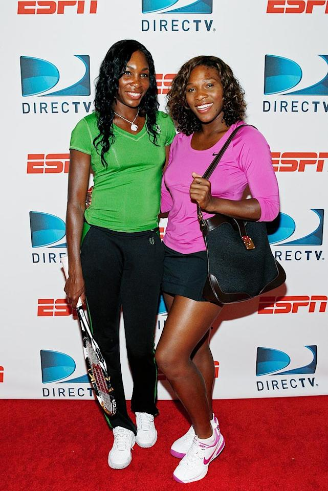 "Venus and Serena Williams strike a cute pose at the ""DIRECTV ESPN US Open Experience,"" a free tennis exhibition and USTA clinic held in NYC's Bryant Park. Mark Von Holden/<a href=""http://www.wireimage.com"" target=""new"">WireImage.com</a> - August 26, 2009"