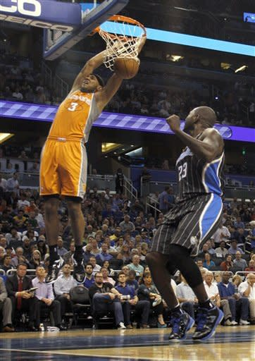 Orlando Magic guard Jason Richardson (23) can only watch as Phoenix Suns forward Jared Dudley (3) dunks during the first half of an NBA basketball game, Wednesday, March 21, 2012, in Orlando Fla. (AP Photo/Reinhold Matay)