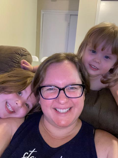 Judy Schmidt, pictured with her two children, hopes that sharing her psoriasis journey empowers and supports others with the skin condition. (Photo courtesy of Judy Schmidt)