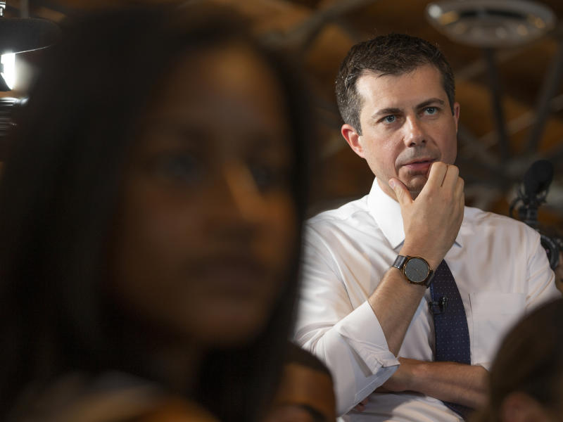 "Democratic presidential candidate and South Bend, Ind., Mayor Pete Buttigieg listens to ""Dream Hustle Code"" students visiting from Chicago, at the Vector90, a coworking space and STEM center created by the late Nipsey Hussle, in Los Angeles, Thursday, July 25, 2019. (AP Photo/Damian Dovarganes)"