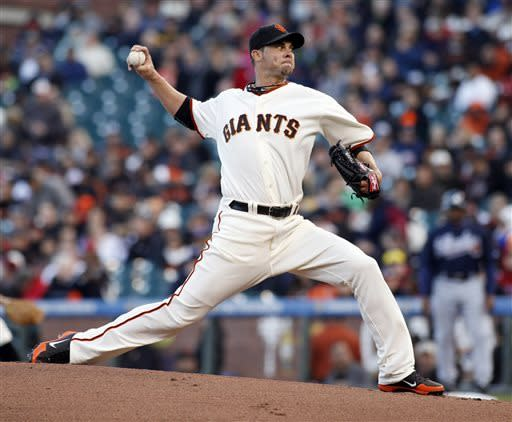San Francisco Giants pitcher Ryan Vogelsong throws to the Atlanta Braves during the first inning of a baseball game, Thursday, May 9, 2013, in San Francisco. (AP Photo/George Nikitin)