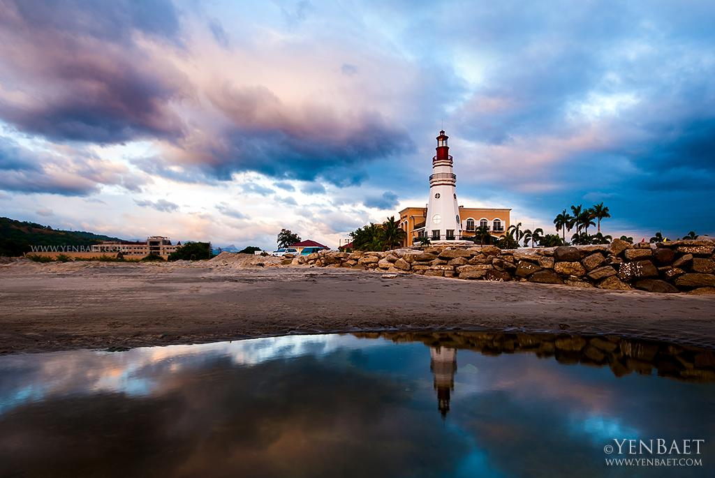 A lighthouse on the beach in Subic Bay, a former U.S. naval base. Its barracks and officers' quarters have been converted to hotels and restaurants. (Yen Baet)