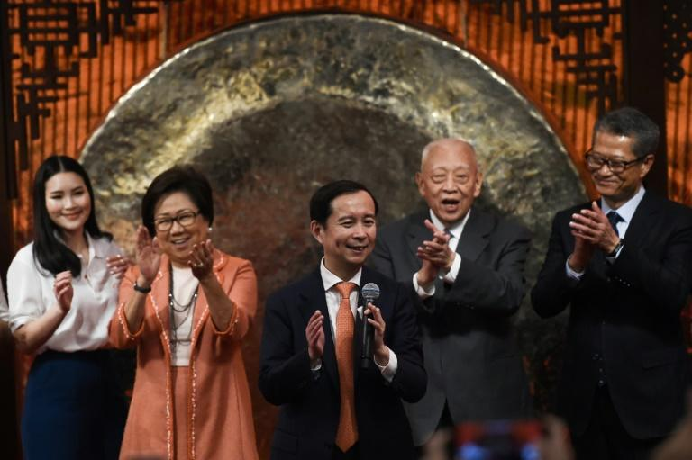 Alibaba CEO Daniel Zhang (C) said the decision to list in Hong Kong was a vote of confidence in the embattled city's markets