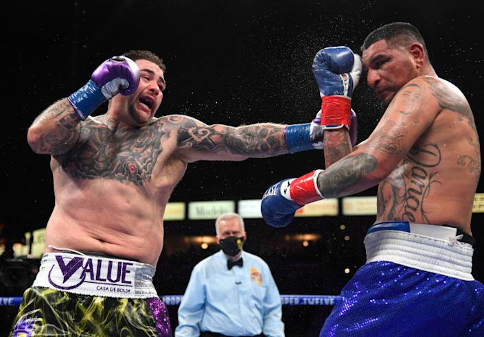 CARSON, CALIFORNIA - MAY 01: (L-R) Andy Ruiz punches Chris Arreola to a 12 round unanimous decision.