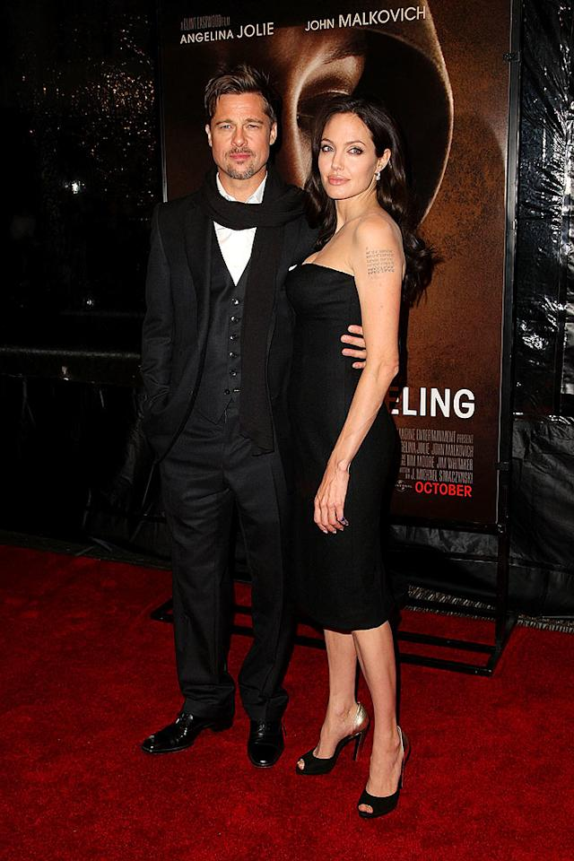 """Angelina Jolie and Brad Pitt hit the red carpet last weekend for the premiere of her new film """"Changeling."""" It was the couple's first red carpet appearance since the birth of their twins in July. Angelina told W magazine that as an adoption advocate, she vowed never to become pregnant, until Brad changed her mind. Andrew H. Walker/<a href=""""http://www.gettyimages.com/"""" target=""""new"""">GettyImages.com</a> - October 4, 2008"""