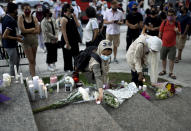 <p>Flowers are placed at a memorial for the four family members who were killed in a vehicle attack that police say was motivated by anti-Muslim hate, in London, Ont., in Ottawa, on Tuesday, June 8, 2021. THE CANADIAN PRESS/Justin Tang</p>