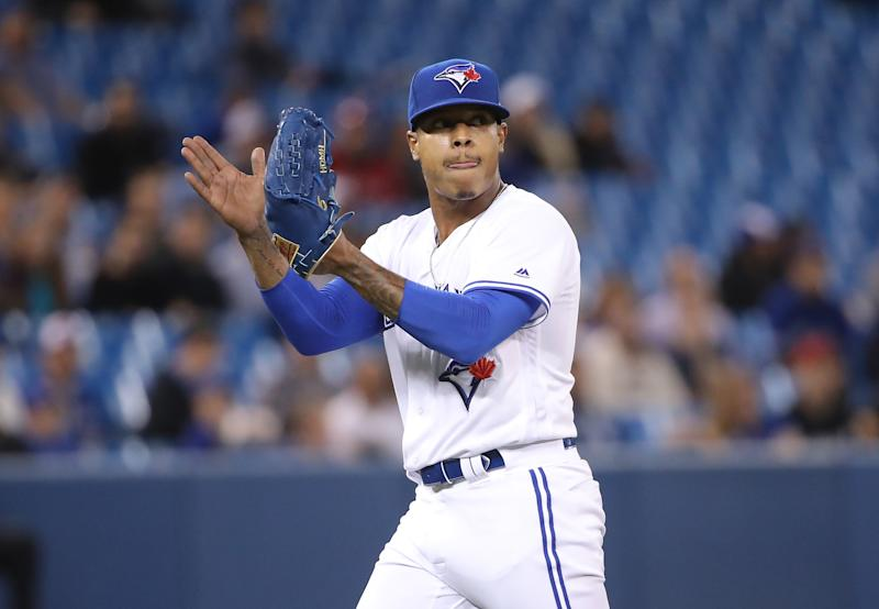 TORONTO, ON - APRIL 02: Marcus Stroman #6 of the Toronto Blue Jays celebrates after getting the last out of the third inning during MLB game action against the Baltimore Orioles at Rogers Centre on April 2, 2019 in Toronto, Canada. (Photo by Tom Szczerbowski/Getty Images)